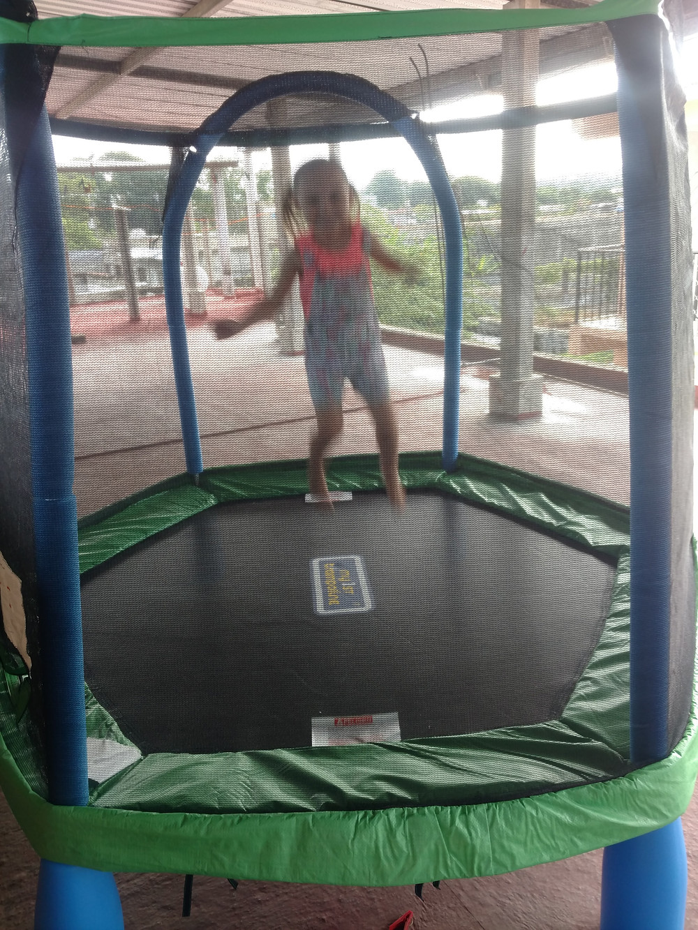 Hope jumping on her and Gideon's early birthday present from mimi and papa