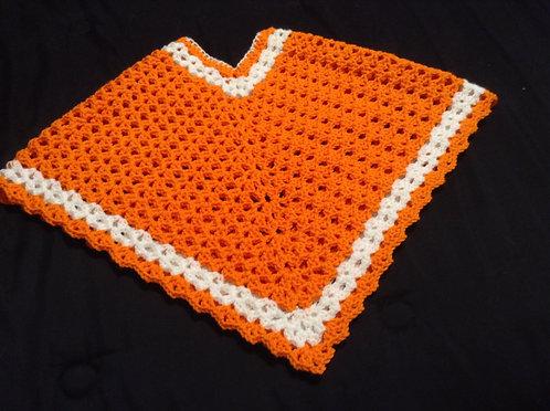 white and orange child poncho