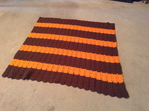 brown and orange child afghan