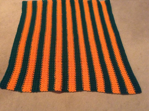 green and orange child afghan
