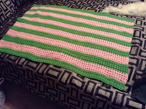 green and pink child afghan