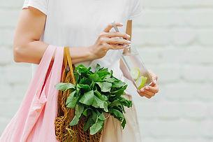 Female hands hold eco bag of vegetables,