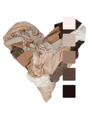 Fabric scraps in various shades of skin tone arranged in a heart shape.  . Palette ranges from light peach to dark brown.
