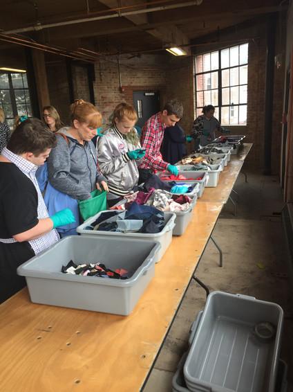 Some Volunteers Sorting Fabric