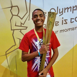 Alex holding the 2012 Olympic Torch