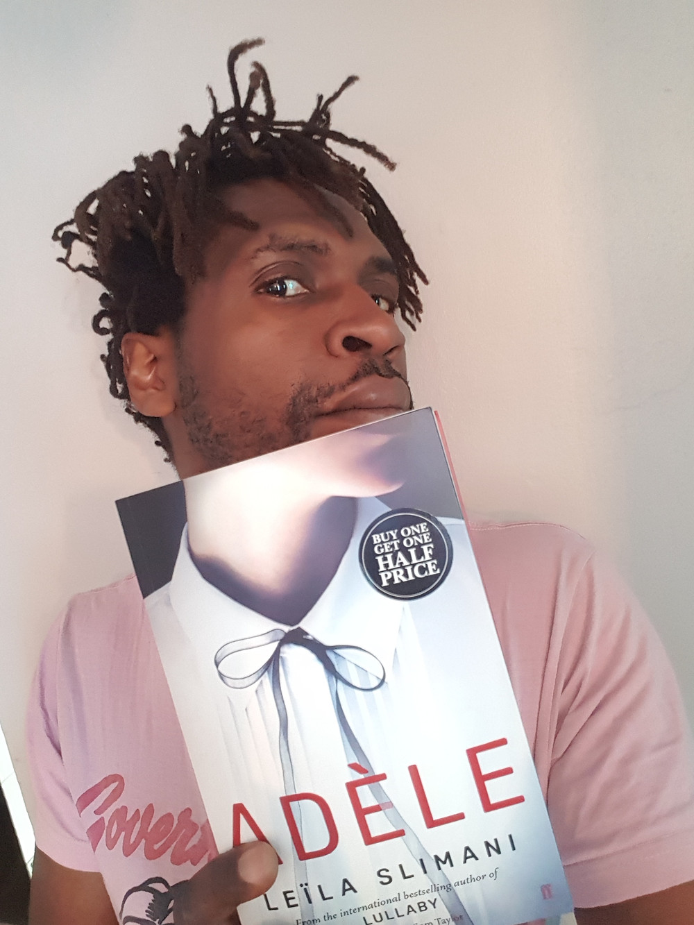 Taj Fregene holds a copy of Adele by Leila Slimani
