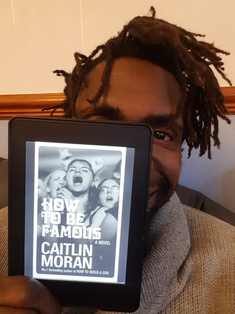 Taj holds a copy of Caitlin Moran's How to be Famous