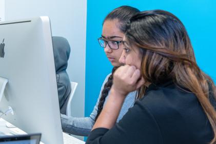 Brampton teacher Sabina assisting a student