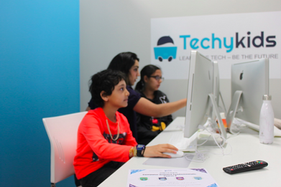 Sabina Working Closely With Our Students at TechyKids Brampton