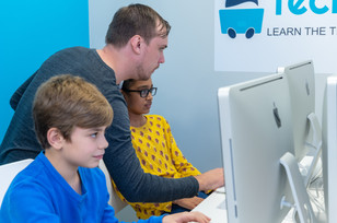 TechyKids Brampton- Teacher assisting students on computers