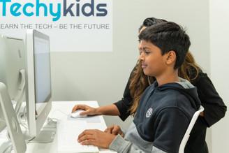 TechyKids teacher assisting student