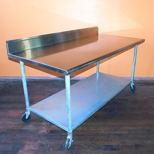 "72"" x 36"" Stainless Steel Table with Backsplash & Casters"