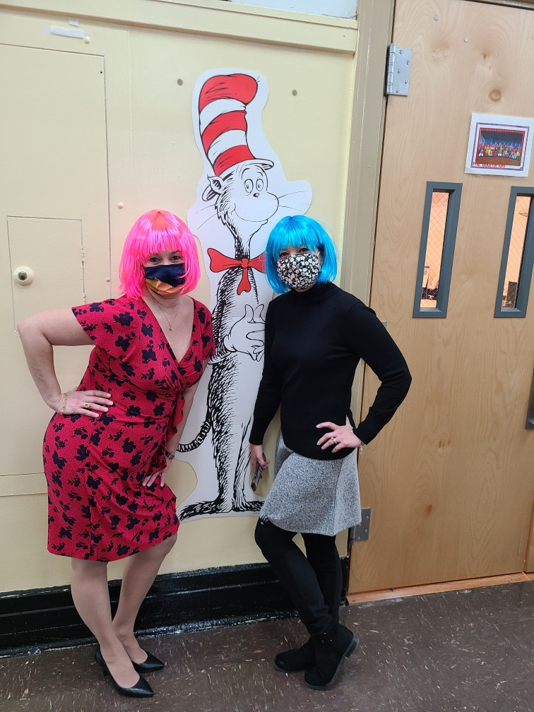 Ms. Annio and Ms. Guido in pink and blue wigs for Wacky Hair Day
