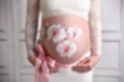 Babybauch Kunst Halle anmalen Fotos