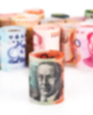 pile-of-rolled-up-currency-notes-with-au