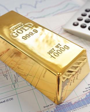 gold-bullion-bar-on-a-stocks-and-shares-