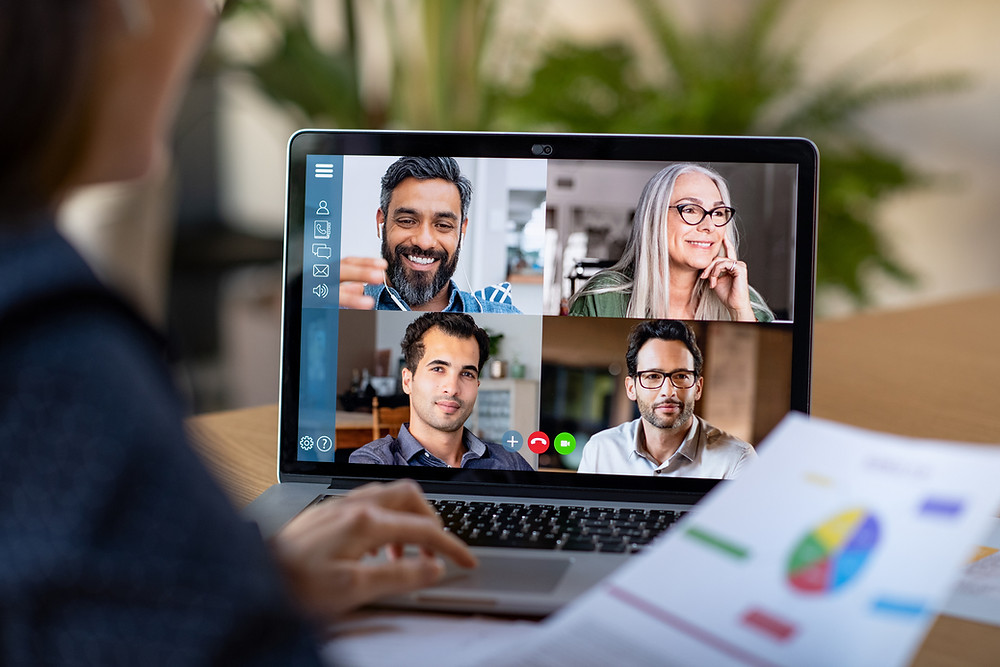 a computer screen with four people video conferencing