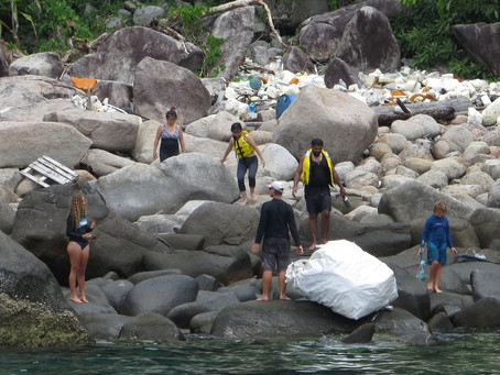 Collecting Ocean Bound Plastics in Tioman Island before it washes out to the sea.