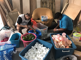Sorting of plastics by the refugees.HEIC