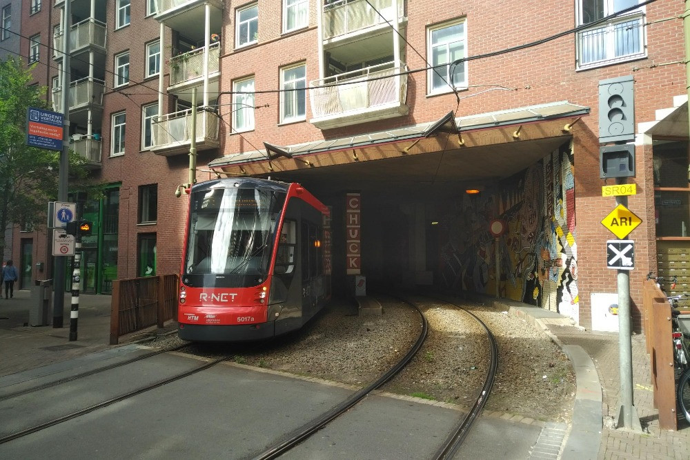 A tramway passing through a building in DenHaag