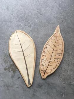white clay leaf plates