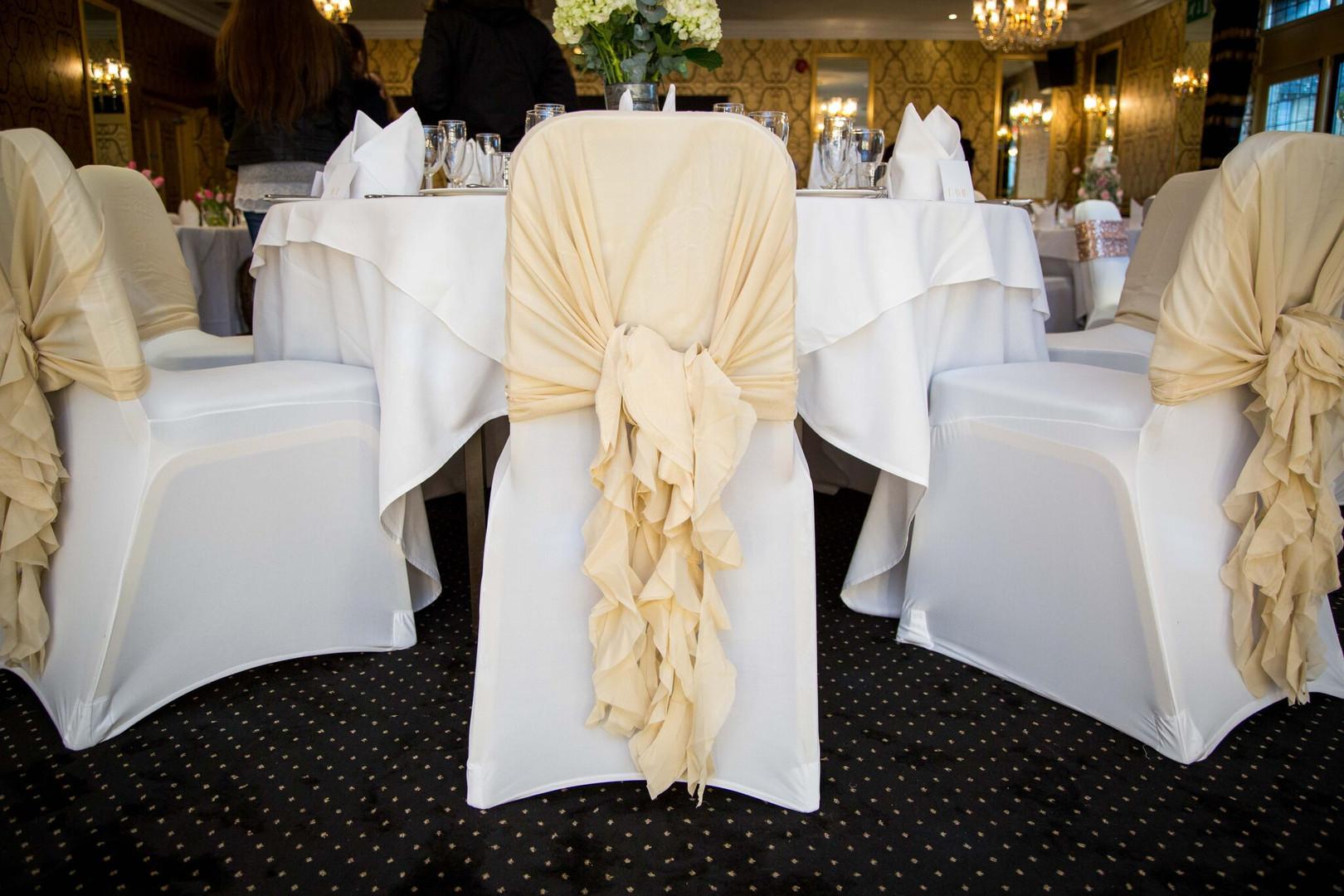Champagne ruffled chair hoods