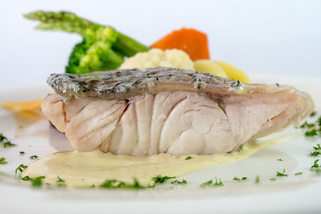 poached barramundi fillet with vegetable