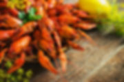 crawfish on wooden background.jpg