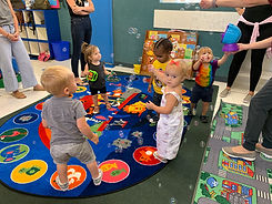 Toddlers playing games in a classroom setting