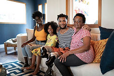 African American family on couch with an amputeed man