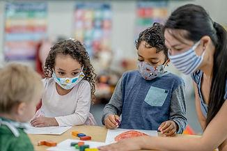 Masked children in classroom.jpg