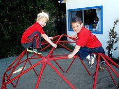 Children outside on playground equipment