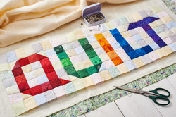 The word quilt sewn from colorful square