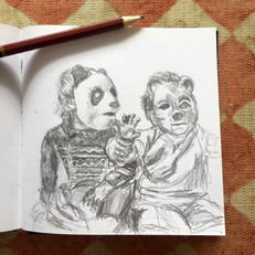 Siblings wearing masks
