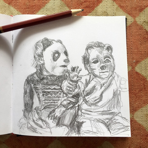 Siblings wearing masks