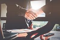 Successful businessmen partnership hands
