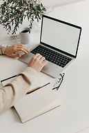 person-using-macbook-pro-on-white-table-