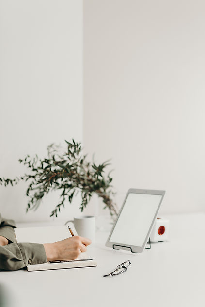person-holding-white-tablet-computer-406