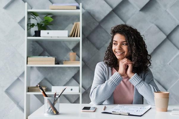ethnic-employee-sitting-workplace-office