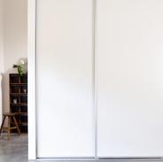 White Vinyl Sliding Doors with Satin Chrome trim