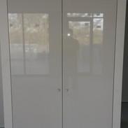 Flush panel hinged doors in gloss finish