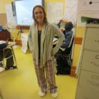Female guidance counselor poses for picture on pajama day at school