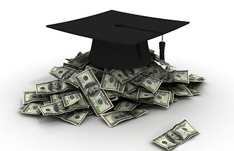 graduation cap sitting on top of a pile of cash