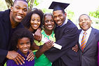 Smiling multi-generational family with graduate