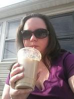 Femaile teacher sips on ice coffee