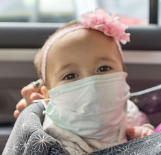 baby with mask in car.jpg
