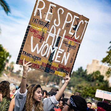 "Demonstrator holding a sign ""Respect All Women"" Photo by T. Chick McClure"