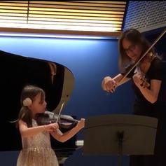 Ms. Celine performing alongside her violin student