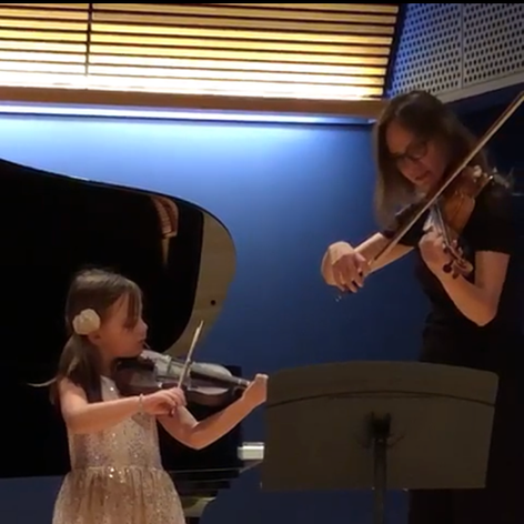 Ms. Celine performing alongside her violin student