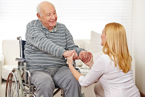 bigstock-Woman-holding-hands-of-old-man-